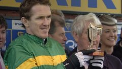AP with his Ryanair Chase trophy - his wife Chanelle is on the right [Photo: Channel 4 Racing]