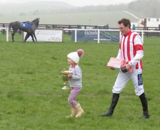 ...but Dad won it - and he's carrying the beer!