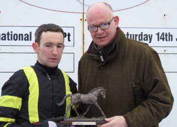 Richard Harding receives Leading Rider award from Andy Clifton Newbury Racecourse's Head of Communications
