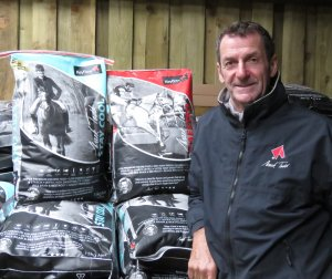 Sir Mark in his feed store of Keyflow products