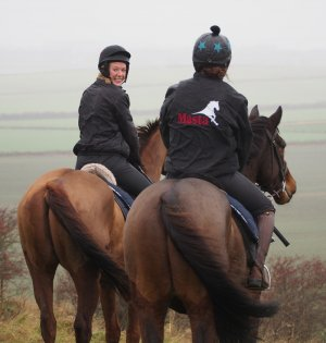 Laura Thomas (left) on the gallops (2014)
