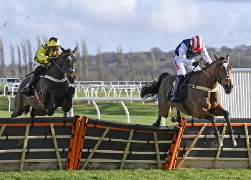 Shishkin & Nico de Boinville (left) gaining on Shakem Up' Harry to win the MansionBet sponsored novices' hurdle