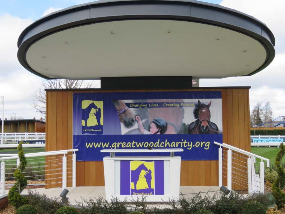 Newbury's presentation podium dressed for the Greatwood Charity Raceday