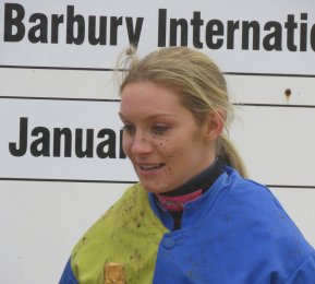 A mud-spattered Maxine O'Sullivan after her first race victory