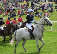 2016: Jonelle taking part in Barbury's Champions' Challenge against a team of jockeys