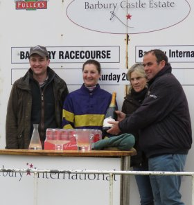 Ally Stirling receives her prize from Barbury trainer Alan King