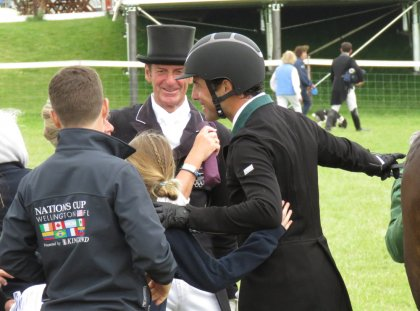 Team trainer Sir Mark Todd joins in the Brazilian rider's celebrations
