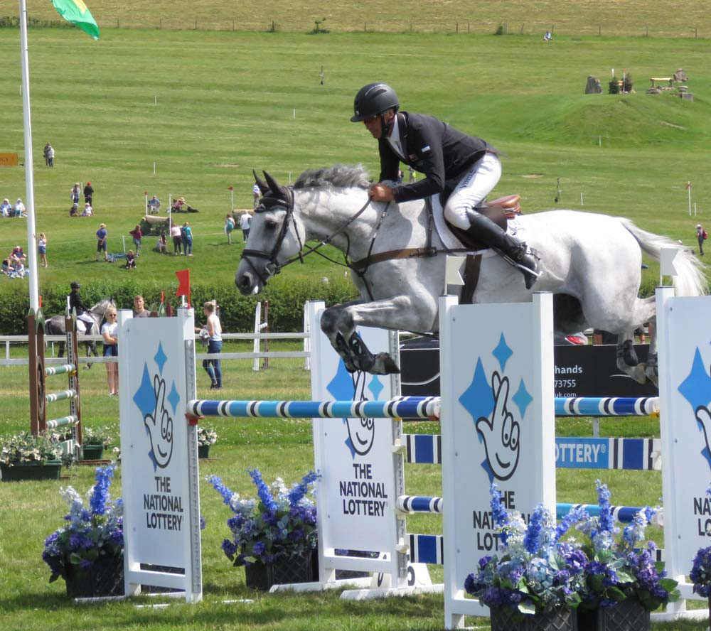 Andrew Nicholson & Swallow Springs on their way to a clear show jumping round