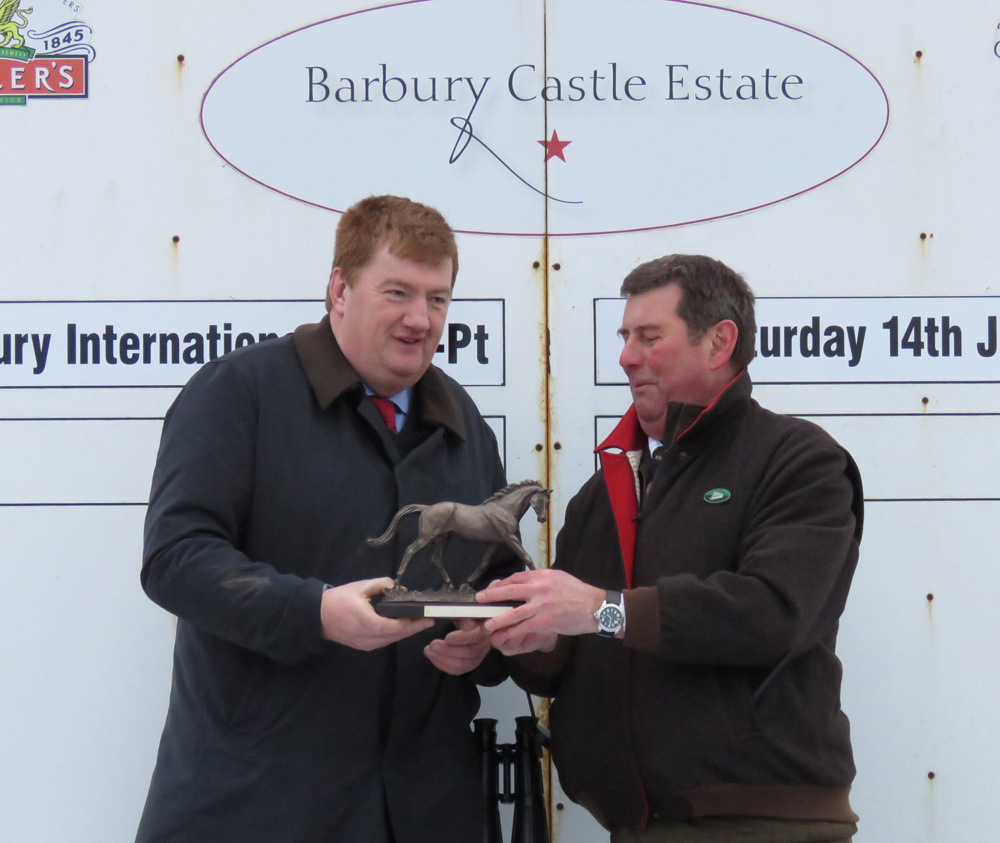 2017: Barbury International founder Nigel Bunter (right) presents trophy to Shark Hanlon