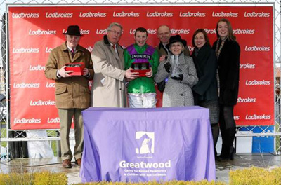 Mike O'Kane presenting mementoes to winning connections of Gala Ball, who won The Ladbrokes Supporting Greatwood Handicap Hurdle Race