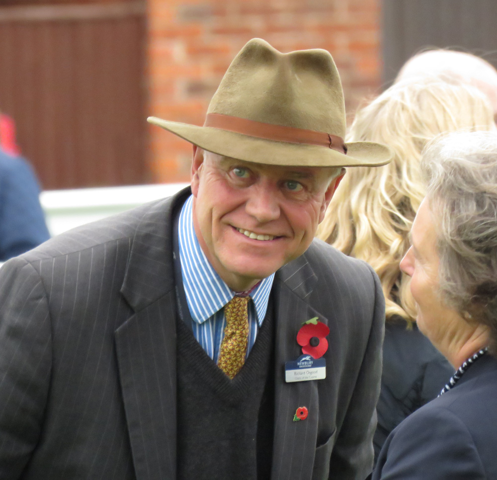 Richard Osgood talking to connections in Newbury's parade ring